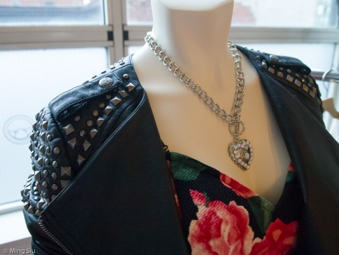 Studded leather jacket with flower-print dress